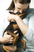 Woman and Miniature Pinscher dog. — Stock Photo
