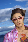 Young Man With Sunglasses and Headscarf — Stock Photo