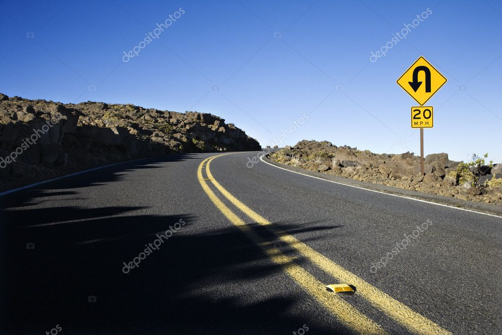 Road and curve in road sign in Haleakala National Park, Maui, Hawaii. — Stock Photo #9424690