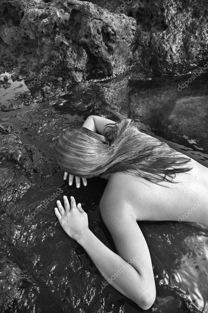 Nude Woman On Rock Stock Image