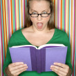 Shocked woman reading book. — Stock Photo #9431662
