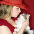 Stock Photo: Young woman holding fluffy cat.