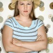 Royalty-Free Stock Photo: Woman pouting with arms crossed.