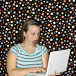 Woman with laptop looking surprised. — Stock Photo