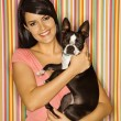 Stock Photo: Woman holding Boston Terrier dog.
