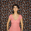 Woman on polka dot background. — Stockfoto