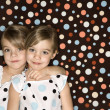 Stock Photo: Twin girl sisters.