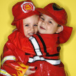 Twin boys dressed as firemen. — Stock Photo