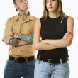 Stock Photo: Teen girl and tattooed man.