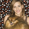 Teen girl holding Pomeranian dog. — Stock Photo