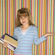 Girl holding books. — Stock Photo