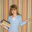 Stock Photo: Girl holding books.