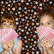 Girls holding playing cards. — Stock Photo