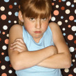 Girl pouting with arms crossed. - Stock Photo