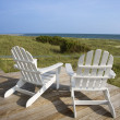 Chairs on Deck Facing Ocean - Foto Stock