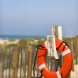 Life preserver on beach. — Stock Photo