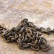 Royalty-Free Stock Photo: Chain on rusty metal.
