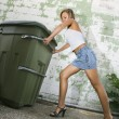 Woman pushing trash can. — Stock Photo