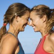Stock Photo: Women head to head smiling.