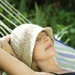 Woman relaxing in hammock. — Stock Photo