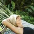 Royalty-Free Stock Photo: Woman relaxing in hammock.