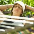Stock Photo: Woman relaxing in hammock.