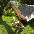 Stock Photo: Woman playing on hammock.