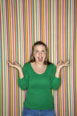 Woman shrugging with mouth open. — Stock Photo