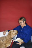 Caucasian man with Goldendoodle dog. — Stock Photo