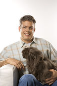 Caucasian man holding Persian cat. — Stock Photo