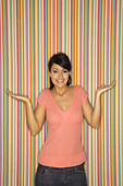 Smiling woman shrugging. — Stock Photo