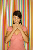 Woman with hands over mouth. — Stock Photo