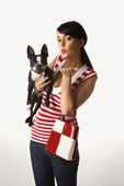 Woman holding Boston Terrier dog. — Stock Photo