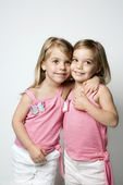 Girl child twin sisters embracing. — Stock Photo