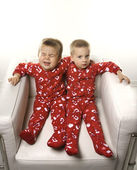 Boy twin brothers sitting together. — Stock Photo