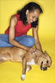Woman petting dog. — Stock Photo