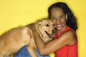 Smiling woman with dog. — Stock Photo