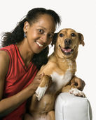 Woman with mixed breed dog. — Stockfoto