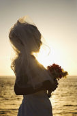 Bride at sunset on beach. — Stock Photo