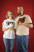 Couple holding chickens. — Stock Photo