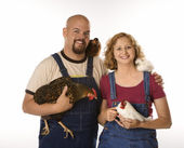 Woman and man with chickens. — Stock Photo