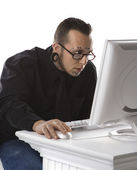 Adult male using computer. — Stock Photo
