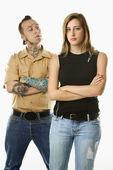 Teen girl and tattooed man. — Stock Photo