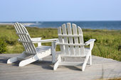 Adirondack chairs overlooking beach on Bald Head Island, North C — Stock Photo