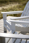 Adirondack chairs at beach. — Stock Photo