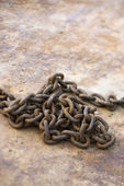 Chain on rusty metal. — Stock Photo
