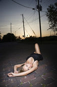 Woman lying in street. — Stock Photo
