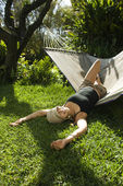 Woman lounging on hammock. — ストック写真