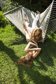 Women playing on hammock. — Stock Photo