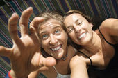 Women being silly in hammock. — Stock Photo